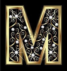 M gold letter with swirly ornaments photo