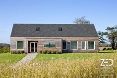 Modern, minimal and high performance vacation home. LEED Gold certified, triple pane windows, simple gable roof, exceptional insulation, and natural cedar siding. Passive House Retreat, Rhode Island. ZeroEnergy.com