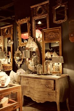 Gotta be on the look out at yard sales and antique shops...wall of gold mirrors in a guest bathroom