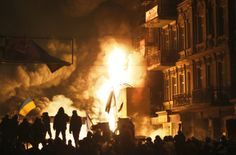 Black smoke and fireballs rise during clashes between protesters and police in central Kiev, Ukraine, early Saturday, Jan. 25, 2014.