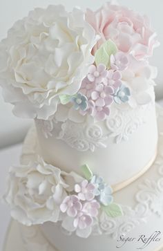Pastel blossoms and peonies wedding cake
