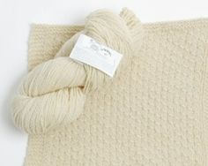 A free knitting pattern for a block-of-the-month afghan featuring Maine Organic by Green Mountain Spinnery!