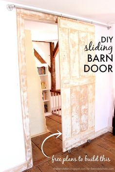 Build an easy DIY sliding barn door -- just 2 steps to build it! plus inexpensive hardware to hang it.