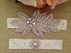 **This beautiful wedding garter set includes a gorgeous rhinestone crystal piece on the main garter. This piece measures about 5in by 2.5in and