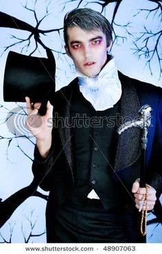 handsome young man with vampire style makeup!!