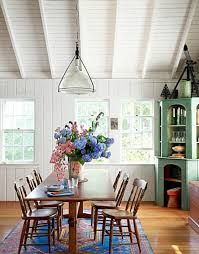 Casual Dining The pared-down architecture, which suggests a country church, suits this Martha's Vineyard cottage's not-so-serious approach. The dining table was made from the wood of a sailboat. Cottage Dining Rooms, Dining Room Table, Dining Area, Dining Corner, Wood Table, Fine Dining, Living Room, Casual Dining Rooms, White Paneling