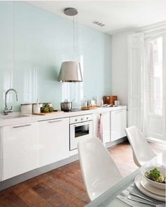 Glass Backsplash Ideas for the Kitchen | Apartment Therapy. Love this baby blue kitchen.