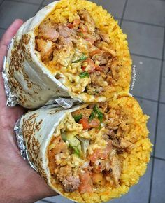 Chicken and Steak Burrito with Spanish Yellow rice Pico de Gallo Cheese and chipotle @peepmysneaks #bestfoodworld TAG YOUR FRIENDS by bestfood_aroundtheworld