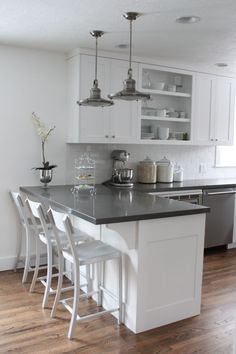 Maybe with the gray walls you don't need darker countertops to offset all that white. If you go gray or black, can they hone rather than polish the surface? don't know if possible with quartz.