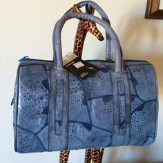 Perfect Spring Bag Beautiful barrel style handbag in an unusual unique blue color. Made from Dyed  frog skin . Measures approximately 11 x 7 with 5 inch drop. New with tags's. Vinyl interior,  1. zip pocket Caribou Handbags Bags