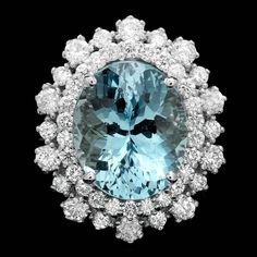 14k Gold 7.00ct Aquamarine 1.70ct Diamond Ring. This luxurious ladies ring is crafted in solid 14k White Gold and features a 7.00 carat 100% Natural Aquamarine mined from Santa Maria, Brazil + accented with 46 sparkling eye-clean natural Diamonds, totaling 1.70 carats. Excellent craftsmanship. Made in USA.