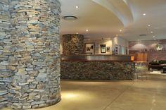 Reception area at Mapungubwe Hotel Natural Stone Wall, Natural Stones, Reception Areas, World Heritage Sites, Lodges, Bouldering, South Africa, African, Cabins
