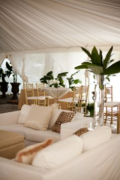 A Charleston Bride, lounge area during reception. White couches and drapes