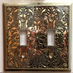 Wall plates come in a variety of colors and styles. This antique brass wall plate has an ornate style that would work well in a formal room.