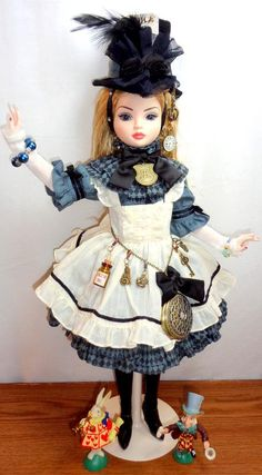 Ellowyne Wilde does a fabulous job of portraying Alice in Dark Wonderland in this embellished Dollheart outfit!