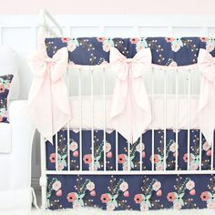 This 2 pc. set features an adorable, fun and modern navy and blush floral flat panel crib skirt with a coordinating solid blush pink crib sheet. This set is perfect for any modern baby girl's nursery!