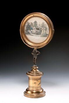 A lovely English Regency gilt metal swing frame dressing table mirror