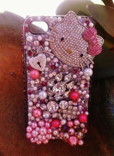 Hello Kitty iPhone 4/4s case @Kayla Babineaux we need to get these for Nina and Leanna