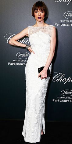 COCO ROCHA We'd be nervous to get purple lipstick all over the white dress, but Coco is braver than we are because she wears the the light-hued embroidered Gabriela Cadena column gown with the vampy lip color to the Chopard Backstage party.