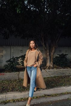 Camel sweater+jeans+nude and black pumps+camel ong coat+navy printed+shoulder bag+gold necklaces+statement earrings. Fall Casual Outfit 2017