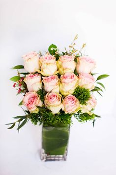 A dozen beautiful blush roses, symmetrically arranged for a striking and architectural design set against green accents. From Flowers by Emily via @Bloompop