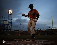 Buster Posey steps up to bat underneath the lights at AT&T Park. | April 25, 2014