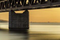 Supporting Öresundsbron http://mabrycampbell.com #image #photo #sweden #malmo #øresund #mabrycampbell #bridge #öresundsbron #sunset #seascape #longexposure