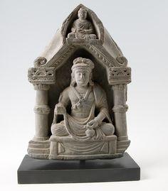 Bodhisattva, seated in vajrasana on a throne between pillars
