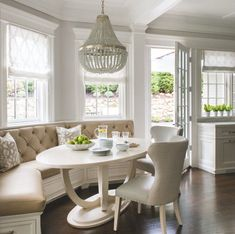 Another breakfast nook window seat with Roman shaded windows. (No to the chandelier-table-chairs! Kitchen Booths, Kitchen Seating, Kitchen Benches, Kitchen Banquette Ideas, Kitchen Layout, Built In Dining Room Seating, Banquet Seating, Corner Breakfast Nooks, Corner Nook