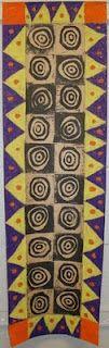 Printmaking inspired by Adinkra symbols.