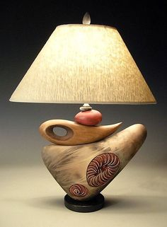 Jan Jacque creates unusual ceramic home decor with a beautiful natural vibe. This lamp made of ceramic and wood is a perfect example of her unique approach.