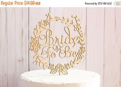 Winter Storm Sale 1/6-1/8     This lovely Bride To Be cake topper features a beautiful floral wreath design and delicate lettering.. Perfect for any style bridal shower..  The cake topper is unfinished wood, so it is ready to be stained or painted in your color of choice.. (If you would like us to stain/paint the cake topper please contact use with details)  Being that the cake topper is unfinished there will be smoke marks around where the laser cuts especially on the back of ...