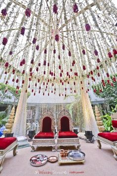 Vedi mandap decorated with high chairs, strings of Jasmines, and strings of jasmine with rose petals ends are suspended from the brass canopy Wedding Mandap, Tent Wedding, Budget Wedding, Wedding Ideas, Wedding Receptions, Wedding Bells, Wedding Favors, Wedding Inspiration, Red Wedding Decorations