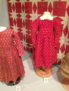 """Girl's dresses in red! Installation from """"Profiles: Chester County Clothing of the 1800s"""" on view through August 2014 #chestercountyhistoricalsociety"""