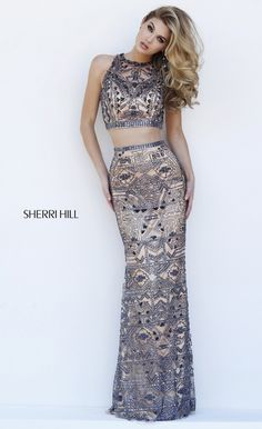 Get glamorous in this fashionable evening dress by Sherri Hill The illusion  bib neckline bodice has a sweetheart lining and features brilliant  contrasting 4ef5466edd8a