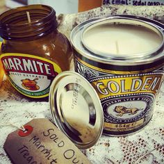 Upcycled candles in marmite and golden syrup jars. Facebook.com/sedgwickscandles