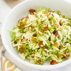 Shaved Brussels Sprout Salad with Apples, Bacon, and Hazelnuts is tossed with creamy maple dressing.  It's addicting!