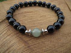 Check out this item in my Etsy shop https://www.etsy.com/listing/239441856/green-aventurine-guru-bead-bracelet