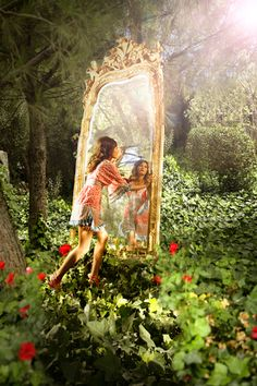 Flamenco Alice in Wonderland.    Put the long mirron in the garden. Guests can take pics of them selves staring at themselves, only have a cheshire cat image hanging midair behind them with invisble wire. Also, behind mirror make it look like a differnt world that they could access viz mirror.