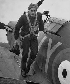 October 1940 RAF ace pilot, South African Albert G. Lewis, standing on the wing of his plane after an engagement with enemy planes during the Battle of Britain. (William Vandivert)
