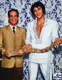 "Elvis receives ""Gold Attendance Award Belt"" from International Hotel president Alex Shoofey - 1969"
