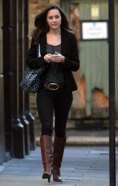 Business casual work outfit: black blazer, black polka dot top, black jeans, brown boots.
