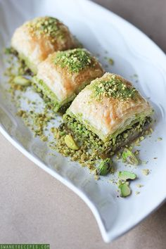 Turkish Pistachio Baklava- This dessert consists of layers of pastry sweetened usually with syrup and made with nuts but any ingredient can be added. Pistachio baklava is very popular throughout Turkey more than any other flavour Turkish Baklava, Lebanese Recipes, Turkish Recipes, Ethnic Recipes, Persian Recipes, Arabic Dessert, Arabic Food, Arabic Sweets, Cooking