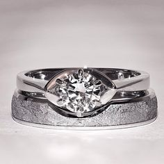 Platinum and diamond engagement ring with matching meteorite wedding band. By Chris Ploof.