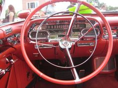 1957 Cadillac - steering wheel and dash photo.