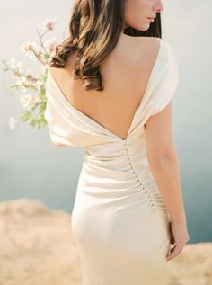 Gorgeous button back detail: Photography : Oliver Fly Photography Read More on SMP: http://www.stylemepretty.com/little-black-book-blog/2016/04/15/pantones-color-of-the-year-sparkles-in-ibiza/