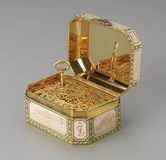 """In 1907 Felix and Nikolai Yusupov gave this Fabergé music box to their parents, Prince Felix and Princess Zenaida, as a twenty-fifth wedding anniversary present. Six of the Yusupov palaces are depicted in sepia enamel panels. When opened, the music box plays """"The White Lady"""" by François Boieldieu, the march of the senior Prince Felix's regiment, the Imperial Horse Guards."""