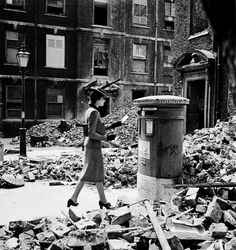 Cecil Beaton took many photographs of bombed-out London, concentrating on the strange juxtapositions the debris provided.  This is 'The Letter', 1940.