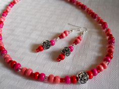 """Perfect+for+Valentine's+or+anytime,+this+beautifully+designed+necklace+and+earrings+set+is+all+handmade,+with+colorful+red+and+pink+wood+beads,+as+well+as+pink+and+red+czech+glass+e-beads+and+centered+with+a+cute+silver+rose+flower+bead!+Connected+by+a+lobster+clasp    Necklace+Size+-+19+1/2"""""""