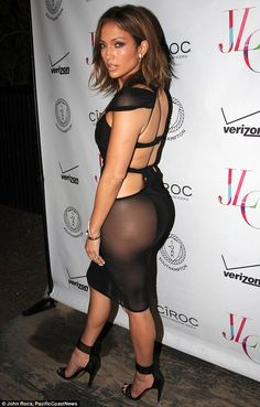 Iconic: She flashed her famous backside in the dress with a sheer detailingat the popular...